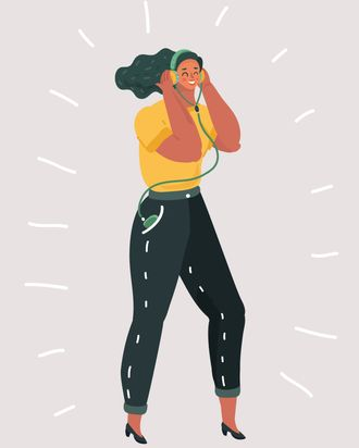 Woman dancing and listening to music through headphones.