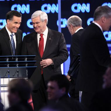Mitt Romney and Newt Gingrich during a break in the debate at the North Charleston Coliseum January 19, 2012 in Charleston, South Carolina.