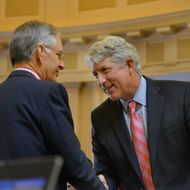 RICHMOND, VA - JANUARY 8:Republican Senator Thomas Norment, L, greets Democrat Attorney General-elect Mark Herring, R, as Virginia's General Assembly re-convenes following holiday break at the Virginia State Capitol on Wednesday, January 8, 2014, in Richmond, VA.  The legislature convenes for the first time in 2014 with the control of the legislature in the balance and with a Democratic governor poised to take power.(Photo by Jahi Chikwendiu/The Washington Post)