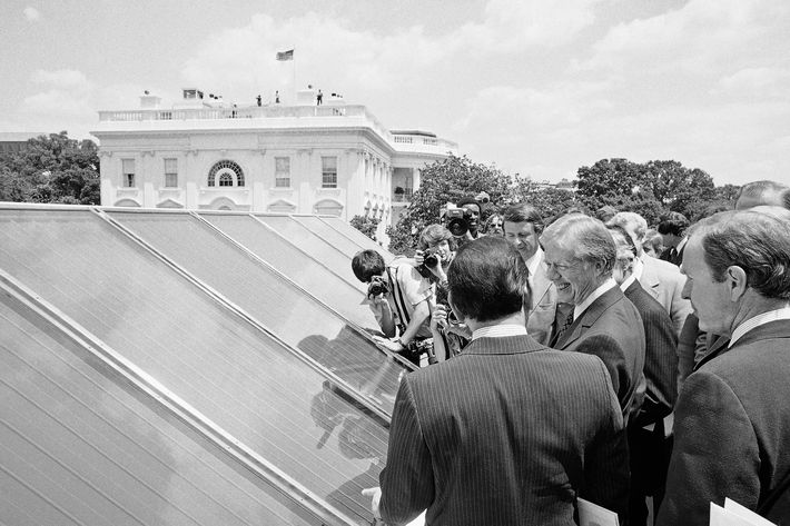 In this June 20, 1979, file photo President Jimmy Carter, center, is surrounded by reporters and photographers as he inspected new White House solar hot water heating system located on the roof of the West Wing of the mansion, over the Cabinet Room.