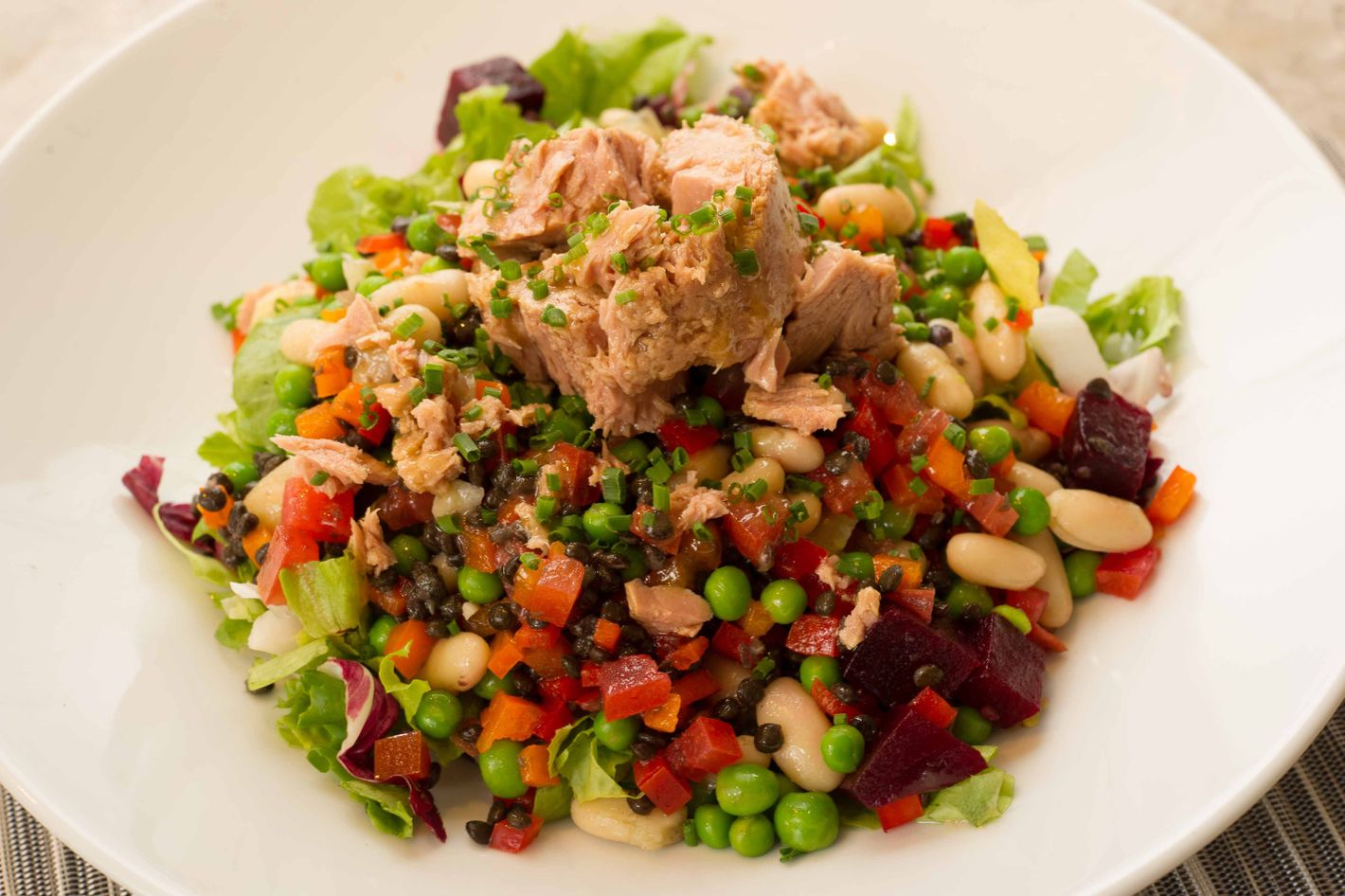 The Fred's Pressman salad: cherry tomatoes, cucumber, peas, lentils, white beans, and beets with Italian tuna.