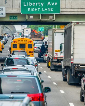 Traffic jam on three lanes on highway through Brooklyn