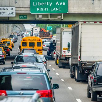 Traffic jam on three lanes on highway through Brooklyn