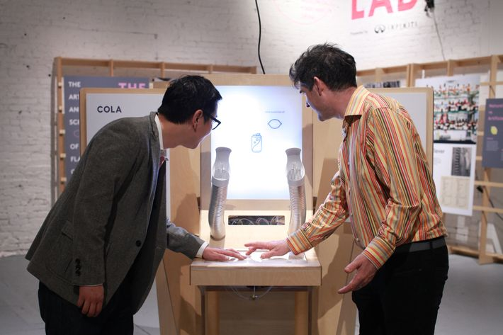 Arnold and Peter Kim, the museum's executive director, using the smell machines.