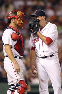 BOSTON, MA - AUGUST 07:  Josh Beckett #19 of the Boston Red Sox and Jason Varitek #33 talk win between pitches in the fourth inning against the New York Yankees on August 7, 2011 at Fenway Park in Boston, Massachusetts.  (Photo by Elsa/Getty Images)
