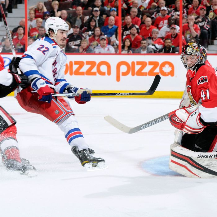 Craig Anderson #41 of the Ottawa Senators stops the puck on a break away attempt by Brian Boyle #22 of the New York Rangers in Game Three of the Eastern Conference Quarterfinals .