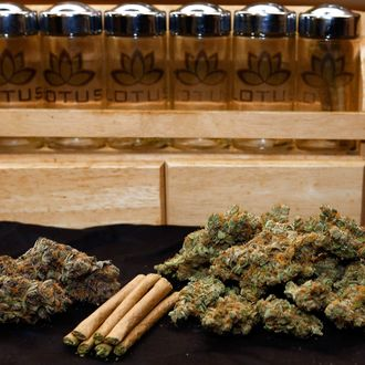 A 1/4 ounce, left, and one ounce of marijuana are pictured along with a handful of joints at a dispensary in Denver on Wednesday, April 24, 2013.