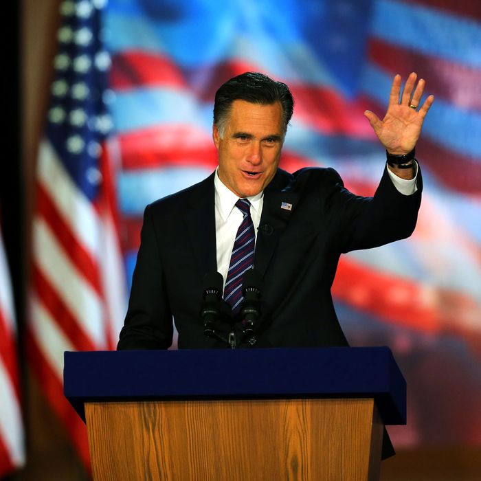 Republican presidential candidate, Mitt Romney, waves to the crowd while speaking at the podium as he concedes the presidency during Mitt Romney's campaign election night event at the Boston Convention & Exhibition Center on November 7, 2012 in Boston, Massachusetts. After voters went to the polls in the heavily contested presidential race, networks projected incumbent U.S. President Barack Obama has won re-election against Republican candidate, former Massachusetts Gov. Mitt Romney.