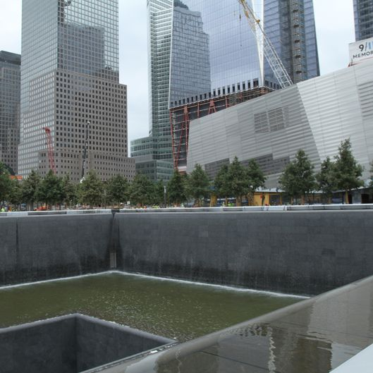 NEW YORK, NY - JULY 23, 2011: (EXCLUSIVE, Premium Rates Apply)   The Memorial Pools are tested with water for the first time as construction continues at Ground Zero in Manhattan July, 23 2011 in New York City. The site is where the World Trade Center stood before the Sept. 11, 2001 terrorist attacks.  (Photo by Steven Rosenbaum/Getty Images)