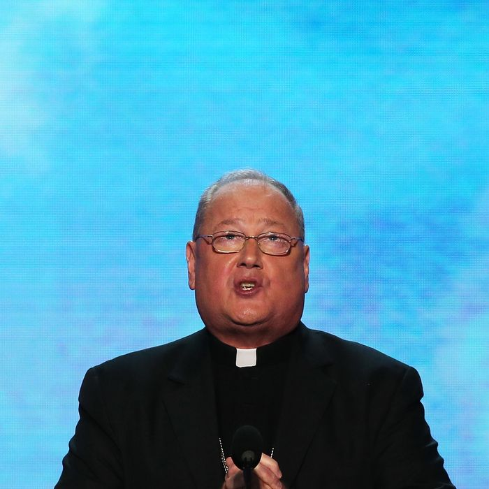 Roman Catholic Cardinal and Archbishop of New York His Eminence Timothy Dolan gives the benediction during the final day of the Democratic National Convention at Time Warner Cable Arena on September 6, 2012 in Charlotte, North Carolina. The DNC, which concludes today, nominated U.S. President Barack Obama as the Democratic presidential candidate.