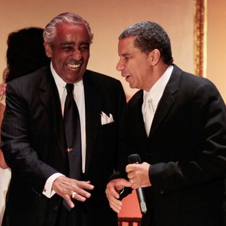 Congressman Charles Rangel (D-NY) laughs with New York Governor David Paterson (R), who emceed the party marking Rangel's 80th birthday August 11, 2010 in New York City. The party and fundraising gala at New York's Plaza Hotel was held on schedule despite a slate of 13 alleged ethics violations against the venerable congressman and a potential House trial in September. Rangel's actual birthday was on June 11.