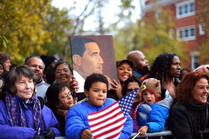People wait to catch a glimpse of US President Barack Obama's motorcade near his house in Chicago on November 7, 2012.