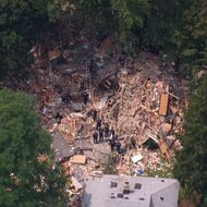 This image taken from video provided by News 12 Long Island shows the wreckage of a house that was destroyed by an apparent gas-related explosion,  killing a toddler and sending 14 other people to hospitals, in the Long Island town of Brentwood, N.Y., Tuesday, Aug. 14, 2012. The entire structure of the house, situated on a block of well-kept, modest homes, was reduced to small shards of wood, plywood, drywall, insulation and other building material.