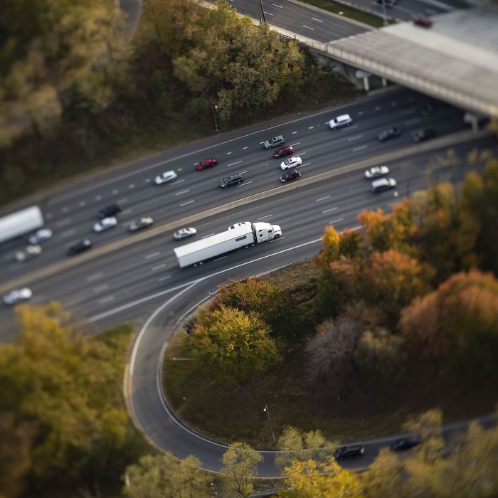 A truck drives on Interstate 495 drives in this aerial photograph taken with a tilt-shift lens above Bethesda, Maryland, U.S., on Tuesday, Nov. 4, 2019.