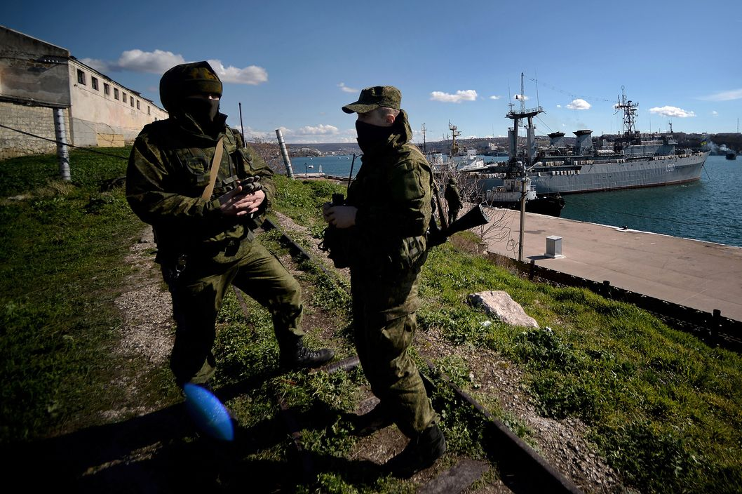 Russian forces patrol near the Ukrainian navy ship Slavutich in the harbor of the Ukrainian city of Sevastopol on March 5, 2014. Russian forces seized partial control of two Ukrainian missile bases in Crimea today as Western and Russian leaders stepped up efforts to defuse the region's worst crisis since the Cold War.