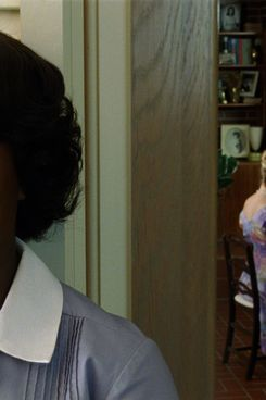 """THE HELP""                  FF-001                  Aibileen Clark (Viola Davis) overhears the exchange between Skeeter Phelan (Emma Stone, center) and her friends in DreamWorks Pictures' drama, ""The Help"", based on the New York Times best-selling novel by Kathryn Stockett.                  ?DreamWorks II Distribution Co., LLC. ?All Rights Reserved."