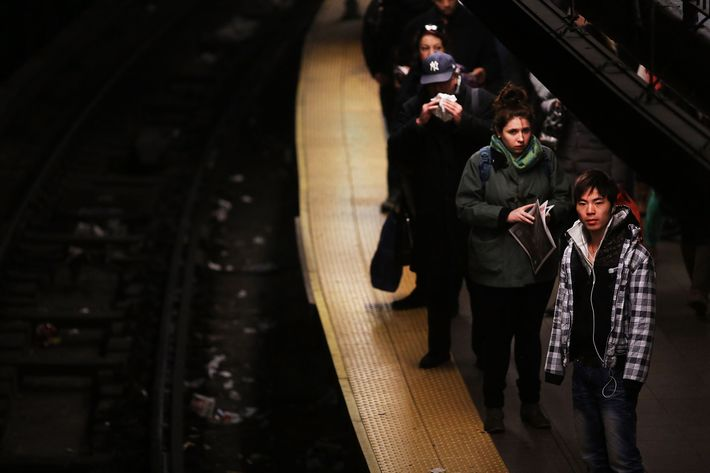 People wait for a subway at a Manhattan station on January 29, 2013 in New York City. The city has been experiencing a rash of high-profile incidents involving individuals being hit by trains in suicides, accidents and people being pushed to their deaths. Lawmakers are planning to discuss the recent deaths while also seeking ideas for more safety on the tracks. The New York City subway system, with 468 stations in operation, is the most extensive public transportation system in the world. It is also one of the world's oldest public transit systems, with the first underground line of the subway opening on October 27, 1904.