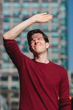 Comedian John Mulaney blocks poses for a portrait in Tribeca on March 9th, 2016.
