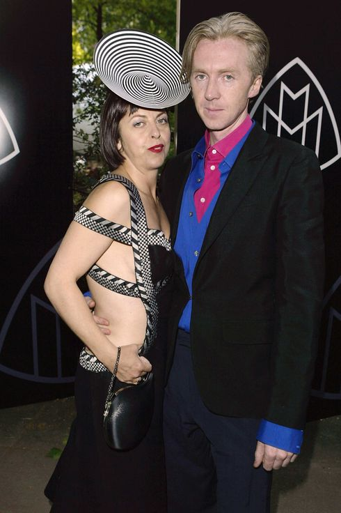 Irish hat maker Philip Treacy (R) and stylist Isabella Blow (L) attend the launch party for the new Mercedes Maybach luxury automobile at Portman Square June 5, 2003 London, England.