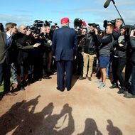 US billionaire Donald Trump (Back Facing) speaks to the media as he arrives at the Women's British Open Golf Championships in Turnberry, Scotland, on July 30, 2015.