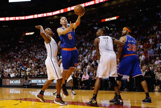 Jason Kidd #5 of the New York Knicks lays the ball up pass Ray Allen #34 of the Miami Heat at American Airlines Arena on December 6, 2012 in Miami, Florida.