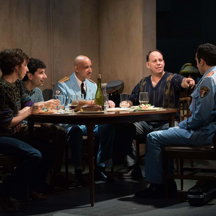 (l-r) Kristen Sieh, John Cariani, Alok Tewari, Andrew Polk, George Abud in Atlantic Theater Company's world premiere musical The Band's Visit, directed by David Cromer, featuring a book by Itamar Moses and original score by David Yazbek. Opening December 8, 2016 at The Linda Gross Theater (336 West 20 Street). Photo: Ahron R. Foster.