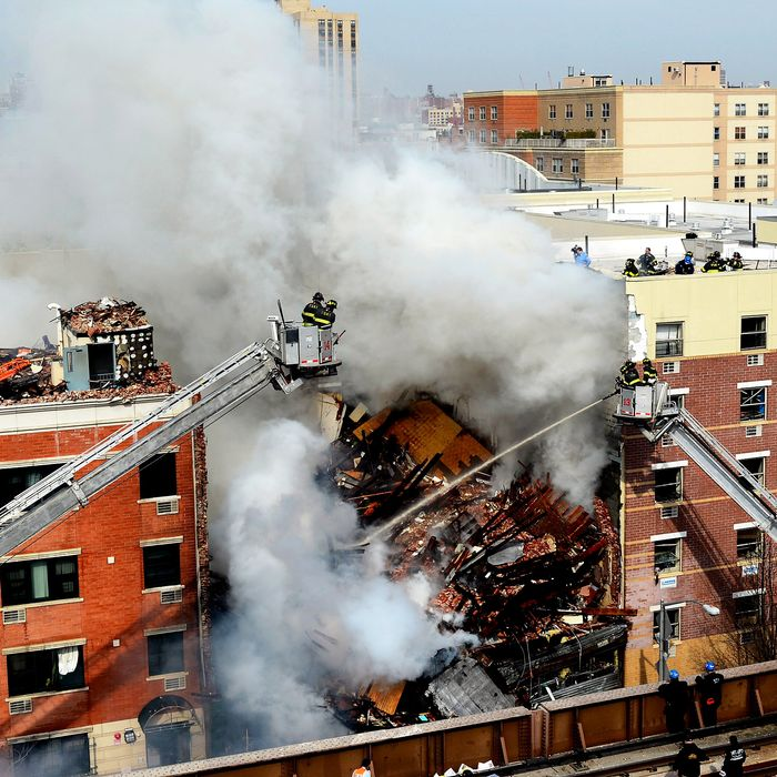 In this image handout provided by the Office of Mayor of New York, firefighters from the Fire Department of New York (FDNY) respond to a five-alarm fire and building collapse at 1646 Park Ave in the Harlem neighborhood of Manhattan March 12, 2014 in New York City. Reports of an explosion were heard before the collapse of two multiple-dwelling buildings at East 116th St. and Park Avenue that left at least 17 injured and a number of people are missing.