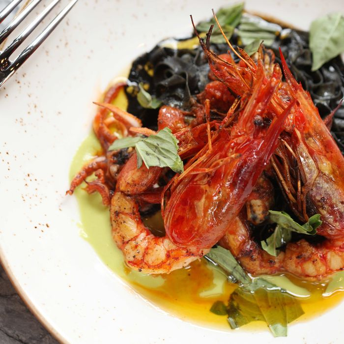 Fresh fettucine with squid ink, Spanish red prawns, mussels, and green-onion sauce.