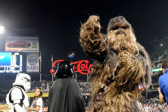 "A person dressed as the ""Star Wars"" character Chewbacca, right, is joined others dressed as characters from the franchise during a promotional appearance at a baseball game between the New York Mets and the Washington Nationals, in New York, Tuesday, Sept. 13, 2011. (AP Photo/Henny Ray Abrams)"