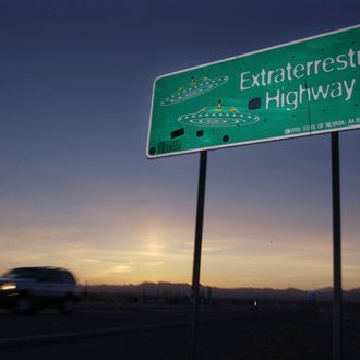 File - A car moves along the Extraterrestrial Highway near Rachel, Nevada, in this Wednesday, April 10, 2002 file photo. The ET highway was established by the Nevada Legislature in 1996 and runs along the eastern border of Area 51, a military base on the Nevada Test Site. George Washington University's National Security Archive obtained a CIA history of the U-2 spy plane program through a public records request and released it Thursday Aug. 15, 2013. (AP Laura Rauch, File)