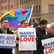 NORFOLK, VA - FEBRUARY 4:  Spencer Geiger, Carl Johansen and Robert Robert Roman protest for equal marriage outside the Walter E. Hoffman U.S. Courthouse as oral arguments in the case of Bostic v Rainey proceed on February 4, 2014 in Norfolk, Virginia, Virginia Attorney General Mark Herring has concluded that Virginia's ban on gay marriage is unconstitutional and he will no longer defend it in federal lawsuits.  (Photo by Jay Paul/Getty Images)