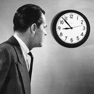 Man looking at clock