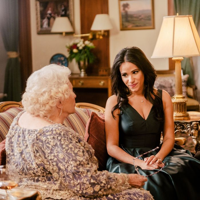 Maggie Sullivun as Queen Elizabeth II, Charlie Field as Prince Harry, and Tiffany Smith as Meghan Markle in Becoming Royal.