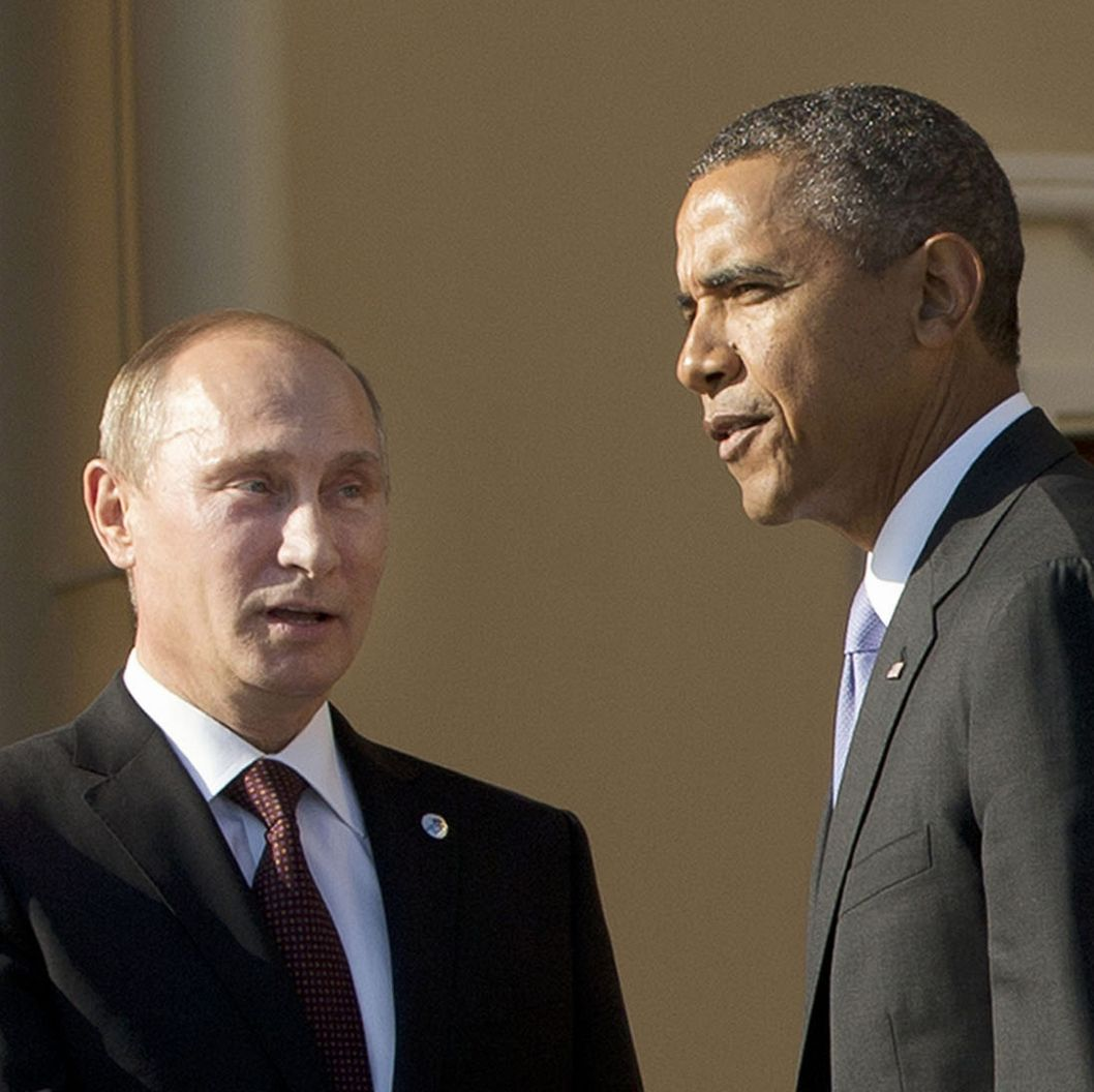 Russias President Vladimir Putin (L) welcomes US President Barack Obama at the start of the G20 summit on September 5, 2013 in Saint Petersburg. Russia hosts the G20 summit hoping to push forward an agenda to stimulate growth but with world leaders distracted by divisions on the prospect of US-led military action in Syria. AFP PHOTO/POOL/Pablo Martinez Monsivais        (Photo credit should read PABLO MARTINEZ MONSIVAIS/AFP/Getty Images)