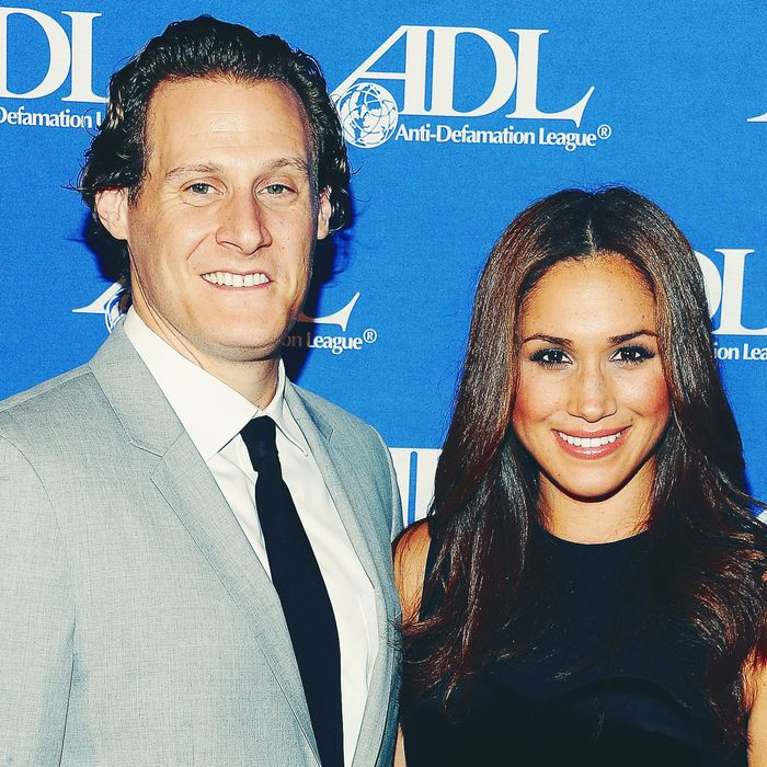 Trevor Engelson and Meghan Markle.