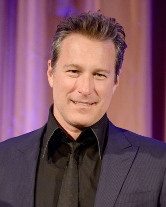 Actor John Corbett speaks onstage during the International Women's Media Foundation's 2013 Courage in Journalism Awards at the Beverly Hills Hotel on October 29, 2013 in Beverly Hills, California.