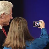 "NEW YORK, NY - SEPTEMBER 24:  Former U.S. President Bill Clinton and NASA astronaut Cady Coleman take a picture of themselves during the Closing Plenary Session: ""Aiming for the Moon and Beyond"" during the fourth day of the Clinton Global Initiative's 10th Annual Meeting at the Sheraton New York Hotel & Towers on September 24, 2014 in New York City.  (Photo by Michael Loccisano/Getty Images)"