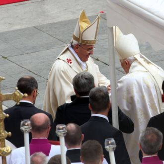 VATICAN CITY, VATICAN - APRIL 27: Pope Francis greets Pope Emeritus Benedict XVI at the end of the Canonization Mass in which John Paul II and John XXIII have been declared Saints on April 27, 2014 in Vatican City, Vatican. Dignitaries, heads of state and Royals from Europe and across the World are to attend the canonisations. (Photo by Franco Origlia/Getty Images)