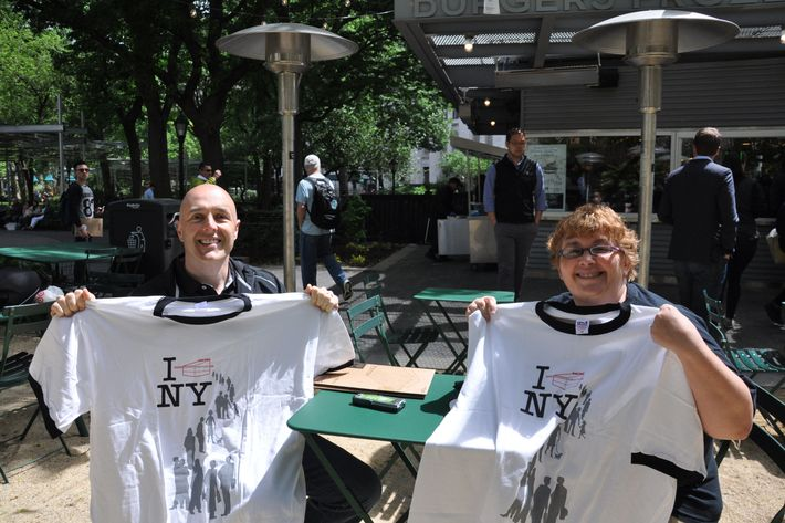 Superfans Gale and Ken McWilliams received free T-shirts.