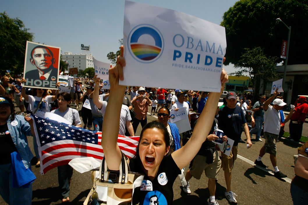 WEST HOLLYWOOD, CA - JUNE 08:  Gay pride participants hold signs in support of Democratic presidential hopeful Barack Obama (D-IL) at the 38th annual LA Pride Parade June 8, 2008 in West Hollywood, California. California gay people are looking forward to the opportunity to legally marry, starting June 17. The California Supreme Court refused to stay its decision legalizing same-sex marriage though conservative and religious opponents called for the court to stop same-sex couples from marrying before their initiative to amend the state constitution to ban gay marriage goes to ballot in November. Some county clerks, including those of Kern, Merced, and Kings Counties, are reportedly threatening to refuse to perform all marriage ceremonies in opposition to the same-sex marriage decision. The parade is expected to draw more than 400,000 people.  (Photo by David McNew/Getty Images)