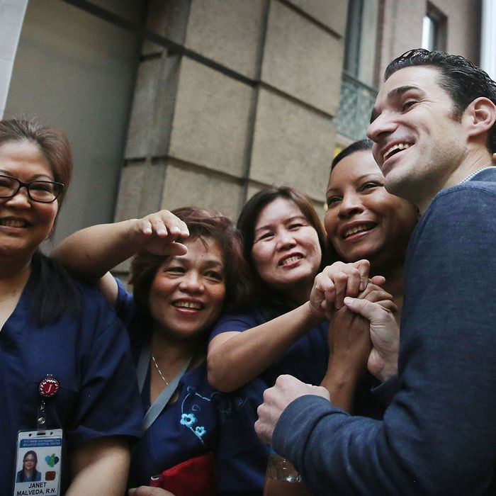 NEW YORK, NY - NOVEMBER 11: Dr. Craig Spencer, who was diagnosed with Ebola in New York City last month, greets some of the nurses who helped him to recovery at a news conference at New York's Bellevue Hospital after being declared free of the disease on November 11, 2014 in New York City. Spencer, a 33 year old Doctors Without Borders physician, was diagnosed last month after returning from treating patients in Guinea. He became the first person to test positive for the deadly virus in the New York City and was treated in isolation at the hospital. Spencer's case started a controversy about voluntary quarantine after he travelled the city in the days after returning from Africa unaware that he was carrying the virus. After being released, Spencer he is expected to return to his apartment in the New York City neighborhood of Hamilton Heights. (Photo by Spencer Platt/Getty Images)