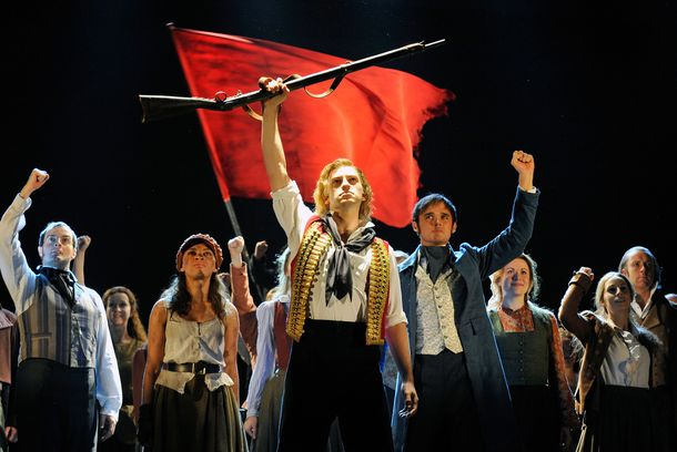 Stage actor Jon Robyns (C), as Enjolras, performs 'Do You Hear The People Sing' during a photo rehearsal for Les Miserables at the Barbican Center in London, Britain, 22 September 2010. A new production of Les Miserables, which is celebrating 25 years of the hit stage play, runs until 02 October.