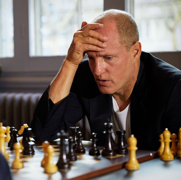 Woody Harrelson playing chess.