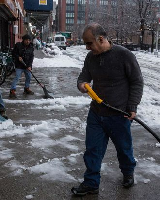 NEW YORK, NY - FEBRUARY 05: Men shovel a snowy sidewalk on February 5, 2014 in the Greenwich Village neighborhood of New York, United States. New York and surrounding regions were hit with yet another snow storm today, bringing snow and ice over night, and sleet and freezing rain during theday. (Photo by Andrew Burton/Getty Images)