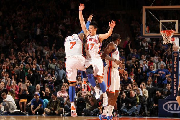 NEW YORK, NY - MARCH 20:  Jeremy Lin #17 and Carmelo Anthony #7 of the New York Knicks react to the game action during the fourth quarter against the Toronto Raptors on March 20, 2012 at Madison Square Garden in New York City.  NOTE TO USER: User expressly acknowledges and agrees that, by downloading and or using this photograph, User is consenting to the terms and conditions of the Getty Images License Agreement. Mandatory Copyright Notice: Copyright 2012 NBAE  (Photo by Nathaniel S. Butler/NBAE via Getty Images)