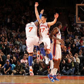 Jeremy Lin #17 and Carmelo Anthony #7 of the New York Knicks react to the game action during the fourth quarter against the Toronto Raptors on March 20, 2012 at Madison Square Garden in New York City.