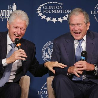 Former U.S. presidents Bill Clinton (L) and George W. Bush share a laugh during an event launching the Presidential Leadership Scholars program at the Newseum September 8, 2014 in Washington, DC. With the cooperation of the Clinton, Bush, Lyndon B. Johnson and George H. W. Bush presidential libraries and foundations, the new scholarship program will provide 'motivated leaders across all sectors an opportunity to study presidential leadership and decision making and learn from key administration officials, practitioners and leading academics.' (Photo by Chip Somodevilla/Getty Images)
