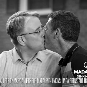 Richard Madaleno and his husband kissing.