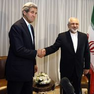 Iranian Foreign Minister Mohammad Javad Zarif shakes hands on January 14, 2015 with US State Secretary John Kerry in Geneva. Zarif said on January 14 that his meeting with his US counterpart was vital for progress on talks on Tehran's contested nuclear drive. Under an interim deal agreed in November 2013, Iran's stock of fissile material has been diluted from 20 percent enriched uranium to five percent, in exchange for limited sanctions relief.