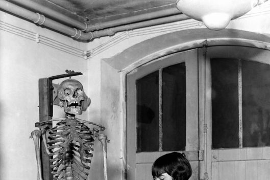 A young woman studying a skeleton for a science class in a school of Technology for women on January 01, 1929. (Photo by Gamma-Keystone via Getty Images)